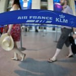 Passengers check-in at Air France counter at the Nice International airport
